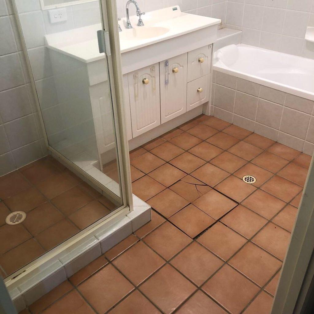 Before shot of tired old Keperra bathroom. Broken tiles and dated bathroom design.